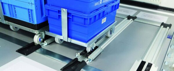 Parking slot rails for warehouse material supply