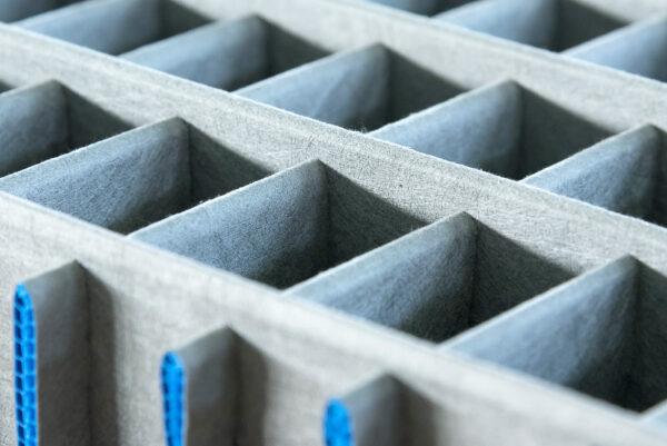 Cartonplast compartmentations laminated with non woven textile